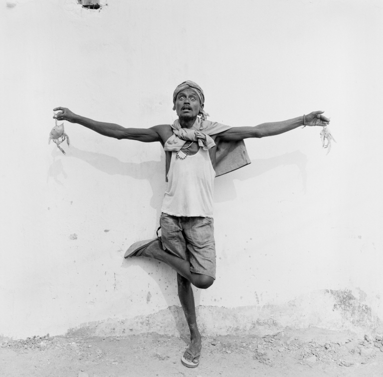 Man from Puri with his lunch (crabs). Image copyright Jason Scott Tilley.