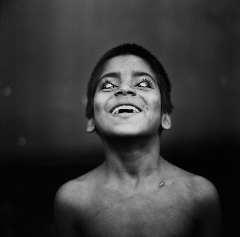 Street child Platform 14 CST station Mumbai. Image copyright Jason Scott Tilley.